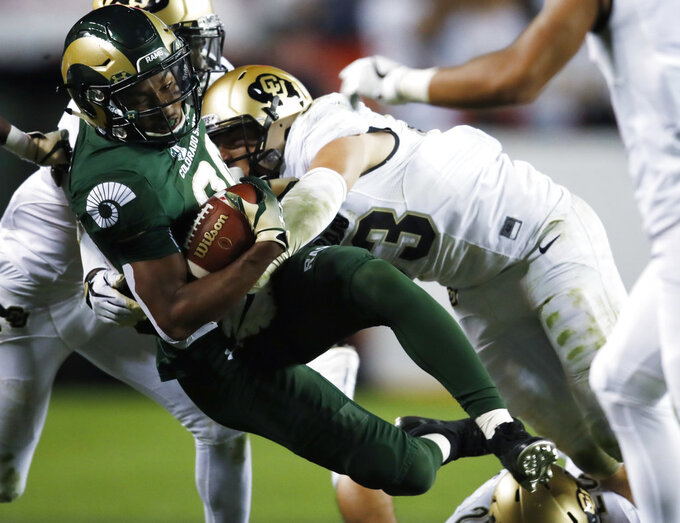 FILE - In this Aug. 31, 2018, file photo, Colorado State wide receiver Nikko Hall, left, is tackled by Colorado linebacker Nate Landman in the second half of an NCAA college football game in Denver. Through three games Colorado sophomore linebacker Nate Landman already has 34 tackles. That's double the total he had as a freshman last season. (AP Photo/David Zalubowski, File)