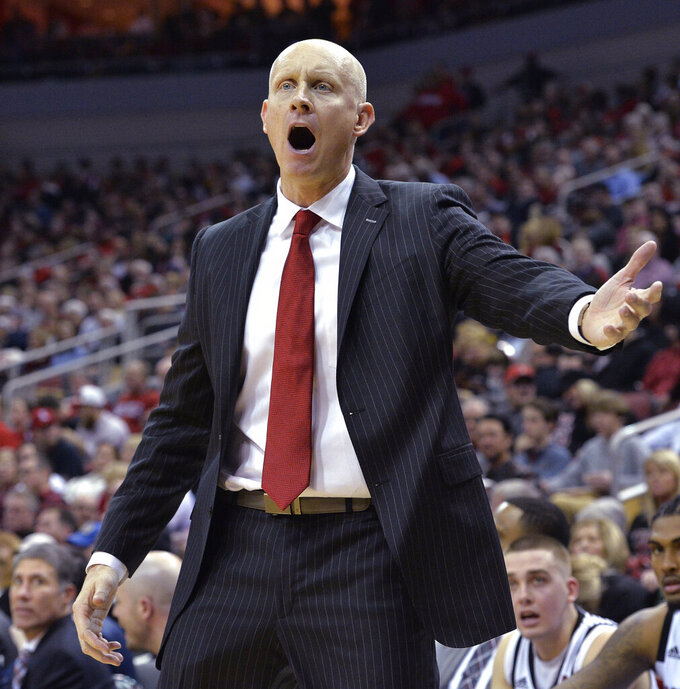 Louisville coach Chris Mack argues a call during the second half of the team's NCAA college basketball game against North Carolina State in Louisville, Ky., Thursday, Jan. 24, 2019. Louisville won 84-77. (AP Photo/Timothy D. Easley)