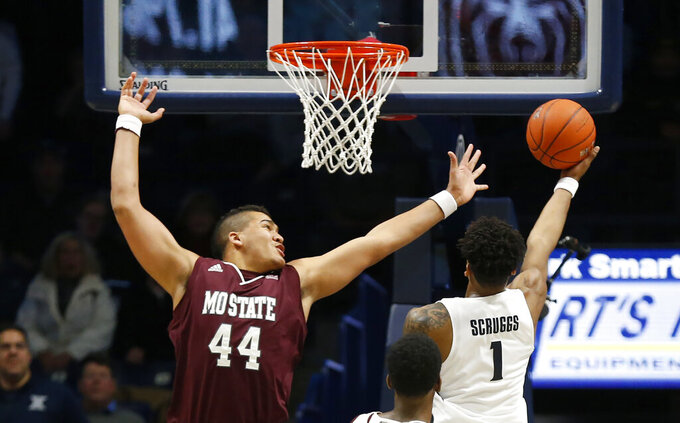 Xavier guard Paul Scruggs (1) puts in two points over Missouri State forward Paul Scruggs (44) in the final seconds of the second half of an NCAA college basketball game, Friday Nov. 15, 2019, in Cincinnati. (AP Photo/Gary Landers)