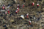 In this Wednesday, Jan. 8, 2020, photo, rescue workers search the scene where a Ukrainian plane crashed in Shahedshahr, southwest of the capital Tehran, Iran. Iran on Saturday, Jan. 11, acknowledged that its armed forces