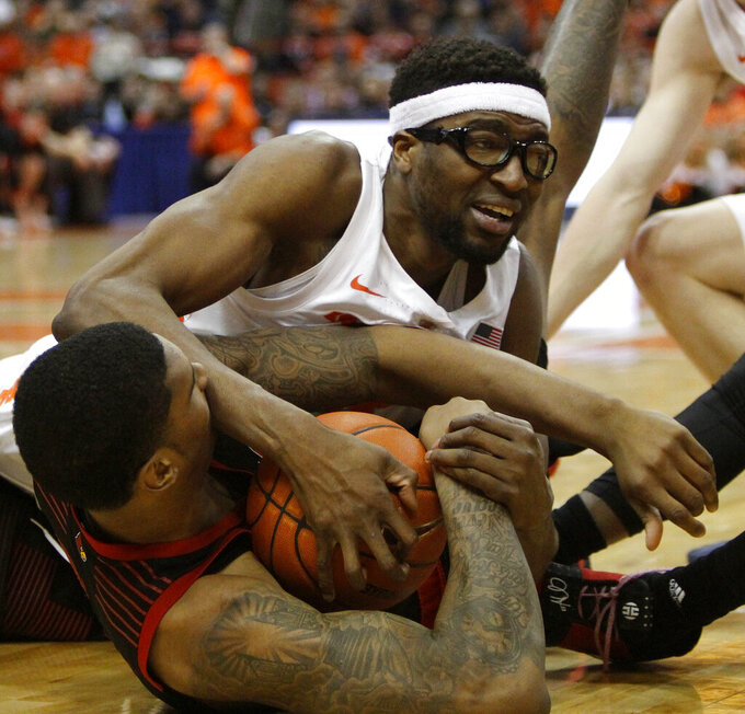 Syracuse's Paschal Chukwu, right, and Louisville's Malik Williams, left, battle for a loose ball during the second half of an NCAA college basketball game in Syracuse, N.Y., Wednesday, Feb. 20, 2019. Syracuse won 69-49. (AP Photo/Nick Lisi)