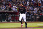 Arizona Diamondbacks' Wilmer Flores crosses home plate after hitting a solo home run against the Los Angeles Dodgers in the fourth inning during a baseball game Saturday, Aug. 31, 2019, in Phoenix. (AP Photo/Rick Scuteri)