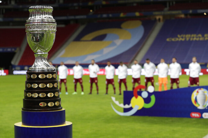 The Copa America trophy is placed on the field prior to the opening match between Brazil and Venezuela at National Stadium in Brasilia, Brazil, Sunday, June 13, 2021. (AP Photo/Eraldo Peres)
