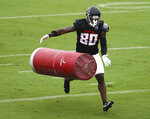 Atlanta Falcons wide receiver Laquon Treadwell hits a tackling dummy during an NFL football training camp practice in Flowery Branch, Ga., Monday, Aug. 24, 2020.  (Curtis Compton/Atlanta Journal-Constitution via AP, Pool