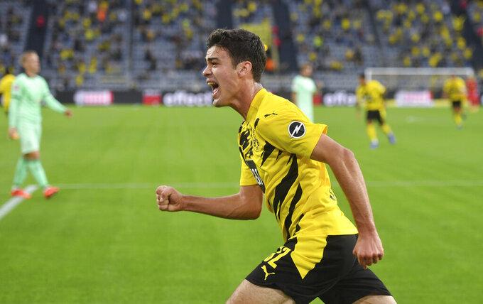 Dortmund's Giovanni Reyna celebrates scoring during the Bundesliga soccer match between Borussia Dortmund and Borussia Monchengladbach at Signal Iduna Park, Dortmund, Germany, Saturday Sept. 19, 2020. (Bernd Thissen/Pool via AP)