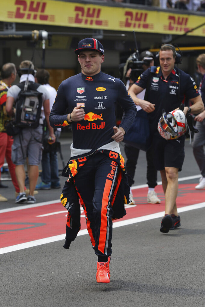 Red Bull driver Max Verstappen, of the Netherlands, runs to pit lane prior to the Formula One Mexico Grand Prix auto race at the Hermanos Rodriguez racetrack in Mexico City, Sunday, Oct. 27, 2019. (AP Photo/Marco Ugarte)
