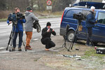 News media film broken glass and car parts on the road side near to the Sandringham Estate, England, where Prince Philip was involved in a road accident late Thursday while he was driving, Friday Jan. 18, 2019. Witnesses say Queen Elizabeth II's 97-year old husband Prince Philip was helped out of his car after it rolled over in the accident on the busy road. (John Stillwell/PA via AP)