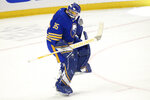 Buffalo Sabres goalie Linus Ullmark (35) celebrates a victory following the shootout of an NHL hockey game against the New York Rangers, Saturday, April 3, 2021, in Buffalo, N.Y. (AP Photo/Jeffrey T. Barnes)
