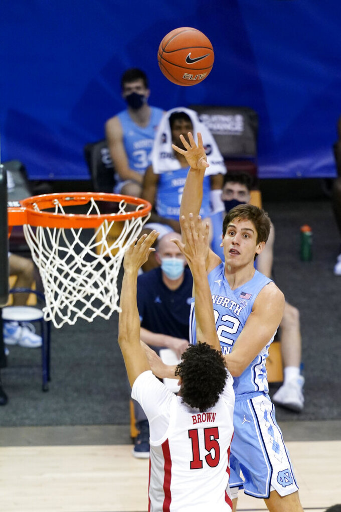 North Carolina forward Walker Miller (22) shoots for the basket over UNLV forward Reece Brown (15) in the second half of an NCAA college basketball game in the Maui Invitational tournament, Monday, Nov. 30, 2020, in Asheville, N.C. (AP Photo/Kathy Kmonicek)