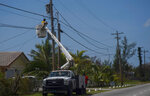 Cable TV is restored after the passing of Hurricane Dorian in Freeport, Bahamas, Wednesday, Sept. 11, 2019. While power has returned to much of Grand Bahama, spokesman Carl Smith for the country's emergency management Agency said the electrical infrastructure around Marsh Harbour, Abaco's largest city, was destroyed. (AP Photo/Ramon Espinosa)