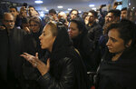 A friend of sailors, who died aboard a tanker that sank off the coast of China, speaks as families, friends and colleagues gather at the headquarters of the National Iranian Tanker Company, in Tehran, Iran, Sunday, Jan. 14, 2018. The burning Iranian tanker listing for days off the coast of China after a collision with another vessel sank Sunday, with an Iranian official saying there was