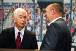 Roger Penske, left, talks with Hy-Vee CEO and president Randy Edeker, right, during a news conference at Hy-Vee Corp. headquarters, Thursday, Aug. 19, 2021, in West Des Moines, Iowa. IndyCar will return next season to Iowa Speedway, a short oval track beloved by fans and drivers that had fallen off the schedule after 14 years. The track located in Newton will host a doubleheader next July in a deal brokered between IndyCar Series owner Roger Penske, team owner Bobby Rahal and grocery chain Hy-Vee. (AP Photo/Charlie Neibergall)
