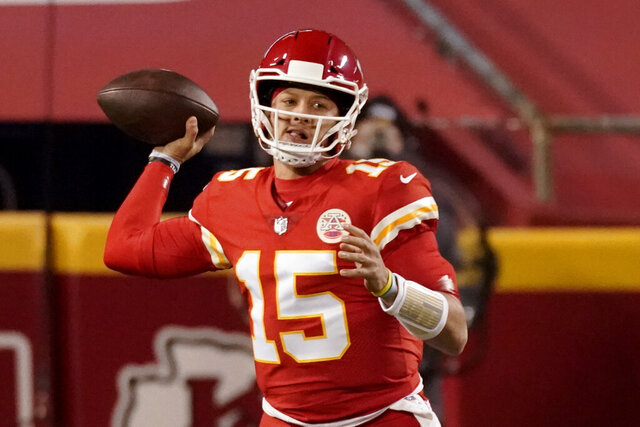 Kansas City Chiefs quarterback Patrick Mahomes thows against the Denver Broncos in the first half of an NFL football game in Kansas City, Mo., Sunday, Dec. 6, 2020. (AP Photo/Charlie Riedel )
