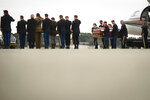 The remains of Staff Sgt. Ian Paul McLaughlin are carried from a plane to an awaiting hearse on Fort Bragg, N.C., on Saturday, Jan. 18, 2020.  McLaughlin was killed Jan. 11 in Afghanistan. (Andrew Craft /The Fayetteville Observer via AP)