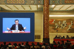 Chinese Premier Li Keqiang is displayed on a screen during a press conference after the closing session of the National People's Congress in Beijing's Great hall of the People on Friday, March 15, 2019. (AP Photo/Ng Han Guan)