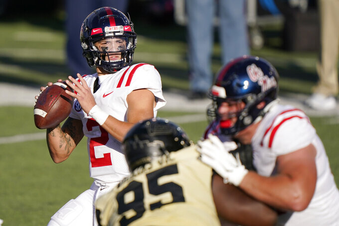 Mississippi quarterback Matt Corral (2) drops back to pass against Vanderbilt in the first half of an NCAA college football game Saturday, Oct. 31, 2020, in Nashville, Tenn. (AP Photo/Mark Humphrey)
