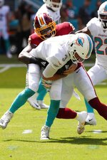 Washington Redskins strong safety Landon Collins (20) sacks Miami Dolphins quarterback Josh Rosen (3), during the first half at an NFL football game, Sunday, Oct. 13, 2019, in Miami Gardens, Fla. (AP Photo/Wilfredo Lee)