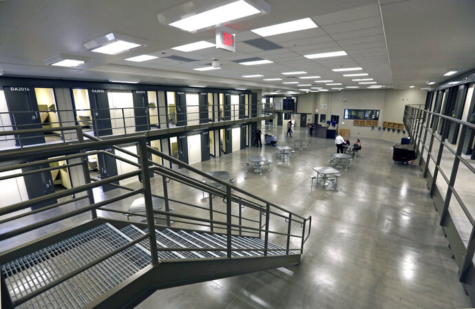FILE – This June 1, 2018, file photo, shows a housing unit in the west section of the State Correctional Institution at Phoenix in Collegeville, Pa. The first phase of transferring more than 2,500 inmates from the 89-year-old state prison at Graterford to the long-delayed $400 million SCI Phoenix prison began Wednesday, July 11, 2018, according to the Pennsylvania Department of Corrections, which plans to bus hundreds of inmates a day to the new prison facility about a mile down the road until all are relocated. (AP Photo/Jacqueline Larma, File)