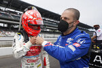 Tony Kanaan, right of Brazil, fist bumps Pietro Fittipaldi, of Brazil, during qualifications for the Indianapolis 500 auto race at Indianapolis Motor Speedway, Saturday, May 22, 2021, in Indianapolis. (AP Photo/Darron Cummings)