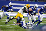 Green Bay Packers' Christian Kirksey, center top, is tackled by Indianapolis Colts' Nyheim Hines (21) during the first half of an NFL football game, Sunday, Nov. 22, 2020, in Indianapolis. (AP Photo/Michael Conroy)