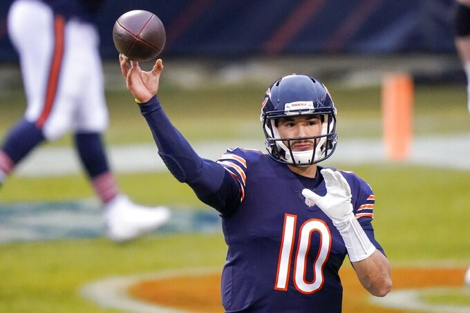 Chicago Bears' Mitchell Trubisky warms up before an NFL football game against the Green Bay Packers Sunday, Jan. 3, 2021, in Chicago. (AP Photo/Nam Y. Huh)