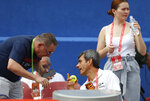 Tennis umpire Carlos Ramos, bottom right, talks to an official prior to the start of the first Davis Cup semifinal singles match between Croatia and the United States in Zadar, Croatia, Friday, Sept. 14, 2018. (AP Photo/Darko Bandic)