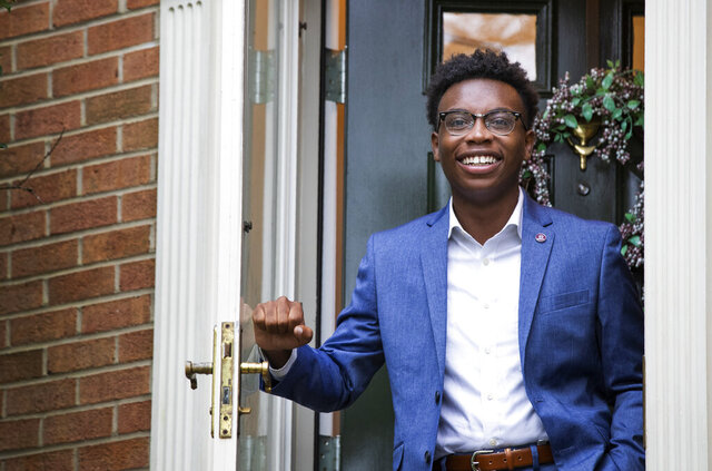 Rick Hart, a volunteer for the Democratic presidential candidate former Vice President Joe Biden, at his family's home in Laurel, Md., Sunday, Aug. 16, 2020. Colleges are reopening with more online learning, and that's proving a challenge for political campaigns, parties and voter registration groups trying to register students. They're trying to figure out how to reach young voters when campuses are empty and students are scattered across the country. (AP Photo/Manuel Balce Ceneta)