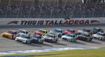 Justin Haley (11) leads the pack at the start of a NASCAR Xfinity auto race at Talladega Superspeedway in Talladega Ala., Saturday, June 20, 2020. (AP Photo/John Bazemore)