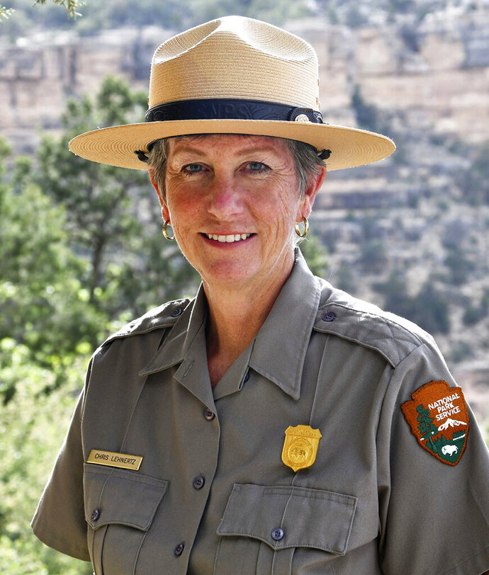 This May 19, 2018, photo released by the National Park Service shows Grand Canyon Superintendent, Christine Lehnertz at the Grand Canyon National Park, Ariz. A U.S. investigation at Grand Canyon National Park has ended with the exoneration of the park's superintendent and an announcement that she'll return to work soon. Lehnertz was reassigned in Oct. 2018, while investigators from the Interior Department's Office of Inspector General looked into undisclosed allegations against her. Deputy Director P. Daniel Smith said the allegations were