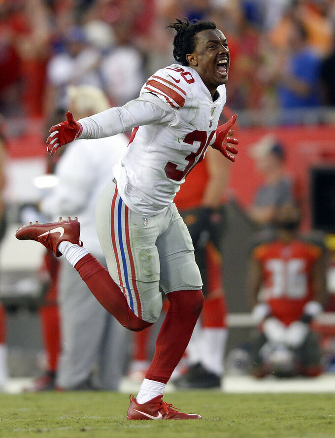 New York Giants cornerback Antonio Hamilton (30) celebrates after the Giants defeated the Tampa Bay Buccaneers during an NFL football game Sunday, Sept. 22, 2019, in Tampa, Fla. (AP Photo/Jason Behnken)