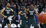 From left, Michigan State forward Kenny Goins (25), guard Cassius Winston (5), and forward Xavier Tillman (23) react after a basket by Brock Washington during the second half of an NCAA college basketball game against Nebraska, Tuesday, March 5, 2019, in East Lansing, Mich. (AP Photo/Carlos Osorio)
