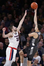 Santa Clara forward DJ Mitchell, right, shoots over Gonzaga forward Killian Tillie during the first half of an NCAA college basketball game in Spokane, Wash., Thursday, Jan. 16, 2020. (AP Photo/Young Kwak)
