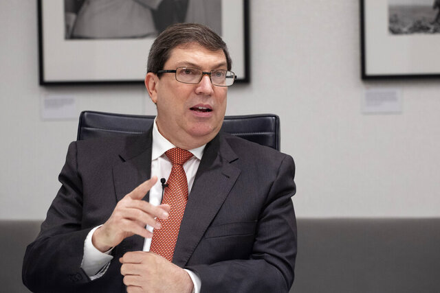"""FILE - In this Oct. 1, 2019  file photo, Cuban Foreign Minister Bruno Rodriguez talks during an interview with The Associated Press, in New York. The foreign minister sent a tweet Tuesday, Nov. 26, 2019, saying unspecified """"illegal actions"""" by the U.S. Embassy in Havana are """"interference in the country's internal affairs"""" and violate both the international codes of conduct for diplomats and the agreement to reopen embassies in Washington and Havana in 2015. (AP Photo/Mark Lennihan)"""