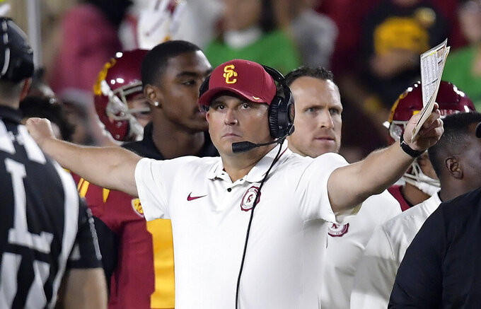 FILE - In this Nov. 24, 2018, file photo, Southern California head coach Clay Helton gestures during the first half of an NCAA college football game against Notre Dame, in Los Angeles. Southern California's bid to secure coach Clay Helton's future begins with a revamped offense, a refurbished classic stadium and a daunting opponent. When USC returns from its first losing season since 2000 to face Mountain West champion Fresno State on Saturday night, the Trojans know they'll need a quick turnaround to placate the hungry critics of Helton, who recruited these players and fostered a family culture at the West Coast's glamour program. (AP Photo/Mark J. Terrill, File)