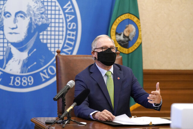 Washington Gov. Jay Inslee speaks during a news conference, Monday, Jan. 18, 2021, at the Capitol in Olympia, Wash. Inslee outlined a plan to set up vaccination sites statewide with help from the National Guard and others as part of an overall goal to vaccinate 45,000 people a day against the coronavirus. (AP Photo/Ted S. Warren)