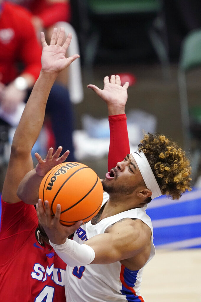Boise State guard Marcus Shaver Jr. drives to the basket over SMU guard Charles Smith IV, left, during the first half of an NCAA college basketball game in the first round of the NIT, Thursday, March 18, 2021, in Frisco, Texas. (AP Photo/Tony Gutierrez)