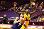 Northwestern's Boo Buie (0) drives past Minnesota's Isaiah Ihnen (35) in the second half of an NCAA college basketball game, Thursday, Feb. 25, 2021, in Minneapolis. (AP Photo/Jim Mone)