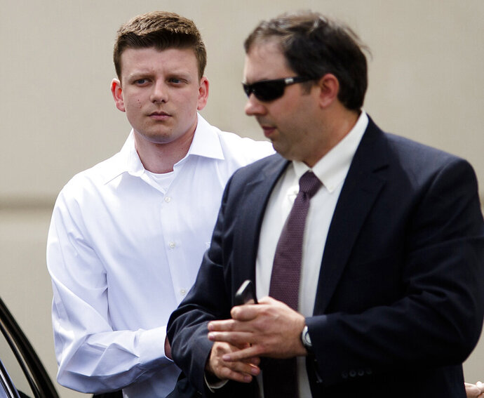 FILE - In this March 24, 2016, file photo, Montgomery Police Officer Aaron Smith, left, arrives for a hearing at the Montgomery County Courthouse in Montgomery, Ala. Lawyers gave opening statements Tuesday, Nov. 19, 2019, in the murder trial of Smith, an Alabama police officer charged with killing an unarmed man. Montgomery police Officer Aaron Cody Smith is charged in the 2016 shooting death of 58-year-old Gregory Gunn. (Albert Cesare/Montgomery Advertiser via AP, FIle)