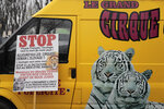 A poster is seen at a circus workers van during a protest near the National Assembly, Tuesday, Jan.26, 2021. French lawmakers start debating Tuesday a bill that would ban using wild animals in traveling circuses and keeping dolphins and whales in captivity in marine parks, amid other measures to better protect animal welfare. Circus workers stage a protest outside the National Assembly to denounce what they consider