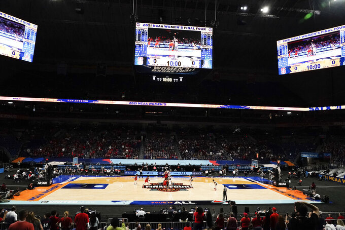 FILE - Players get set for the opening tipoff of the championship game between Stanford and Arizona in the women's Final Four NCAA college basketball tournament in San Antonio, in this Sunday, April 4, 2021, file photo. A law firm hired to investigate gender equity concerns at NCAA championship events released a blistering report Tuesday, Aug. 3, 2021, that recommended holding the men's and women's Final Fours at the same site and offering financial incentives to schools to improve their women's basketball programs. (AP Photo/Morry Gash, File)