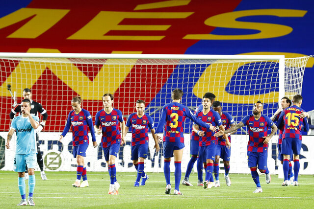FC Barcelona's Antoine Griezmann, third left, after scoring his side's second goal during the Spanish La Liga soccer match between FC Barcelona and Leganes at the Camp Nou stadium in Barcelona, Spain, Tuesday, June 16, 2020. (AP Photo/Joan Montfort)