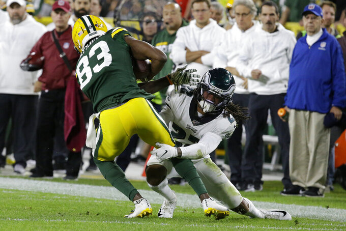 Green Bay Packers wide receiver Marquez Valdes-Scantling is hit by Philadelphia Eagles cornerback Sidney Jones after a reception during the first half of an NFL football game Thursday, Sept. 26, 2019, in Green Bay, Wis. (AP Photo/Mike Roemer)