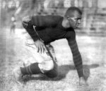 """Frederic """"Duke"""" Slater poses for a photo in 1921 when he was a tackle on the University of Iowa football team. Slater was the NFL's first African-American lineman, and often the only Black player on the field. After retiring, he broke down more racial barriers to become a judge in Chicago. (Chicago Sun-Times via AP)"""