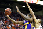 LSU forward Darius Days (0) shoots over Auburn center Austin Wiley (50) during the first half of an NCAA college basketball game Saturday, Feb. 8, 2020, in Auburn, Ala. (AP Photo/Julie Bennett)