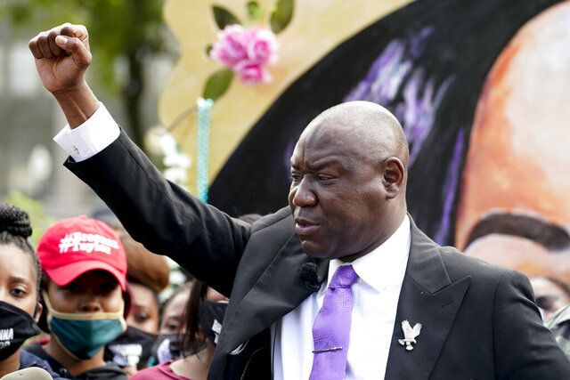 Breonna Taylor family attorney Ben Crump, center speaks during a news conference, Friday, Sept. 25, 2020, in Louisville, Ky. (AP Photo/Darron Cummings)