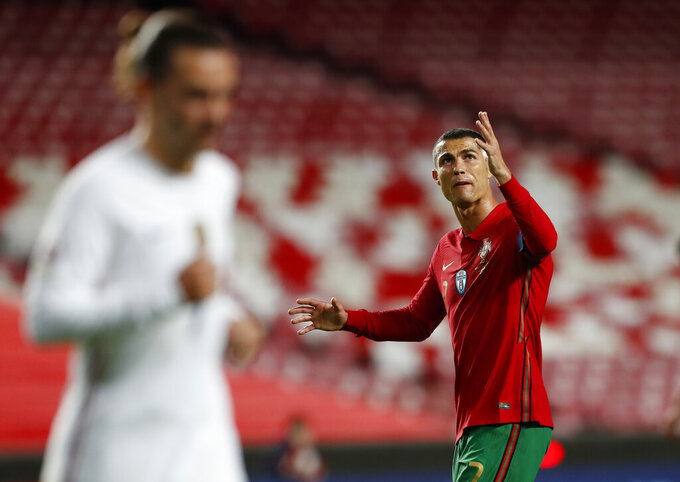 Portugal's Cristiano Ronaldo reacts during the UEFA Nations League soccer match between Portugal and France at the Luz stadium in Lisbon, Saturday, Nov. 14, 2020. (AP Photo/Armando Franca)