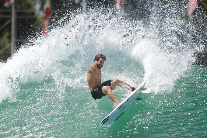 Surfer Italo Ferreira from Brazil works out on a Surf Ranch wave during practice rounds for the upcoming Olympics Tuesday, June 15, 2021, in Lemoore, Calif. This year, Ferreira and fellow Brazilian Gabriel Medina are expected to rule the men's competition at surfing's long-awaited debut as an Olympic sport in the Tokyo 2020 Games. While the surfing community has long pledged that the ocean is for everyone, a look at the professional ranks show a sport that remains expensive and inaccessible. A series of recent industry efforts to help groom the next generation outside of the usual hot spots of Hawaii, California and Australia look to be a tacit acknowledgement of the existing disparities among its talent bench.(AP Photo/Gary Kazanjian)