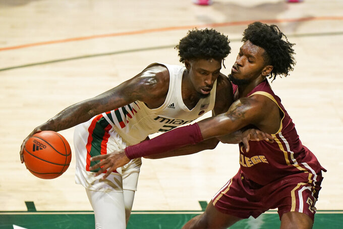 Miami center Nysier Brooks, left, drives up against Boston College forward CJ Felder during the first half of an NCAA college basketball game, Friday, March 5, 2021, in Coral Gables, Fla. (AP Photo/Wilfredo Lee)