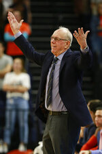 Syracuse head coach Jim Boeheim disputes a call during the first half of an NCAA college basketball game against Virginia in Charlottesville, Va., Saturday, Jan. 11, 2020. (AP Photo/Steve Helber)