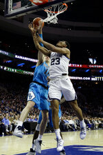 Villanova's Jermaine Samuels (23) goes up for a shot against Georgetown's Greg Malinowski (11) during the first half of an NCAA college basketball game, Sunday, Feb. 3, 2019, in Philadelphia. (AP Photo/Matt Slocum)